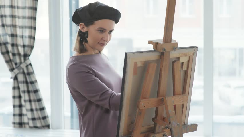 Three friends spend time together, drawing and laughing: female friendship. Three women, different in appearance, communicate in a creative atmosphere. The concept of collaboration, brainstorming. | Shutterstock HD Video #34784110