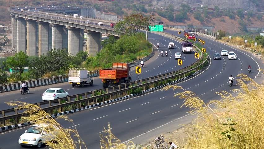 Cars trucks bikes on Indian highway tallest bridge