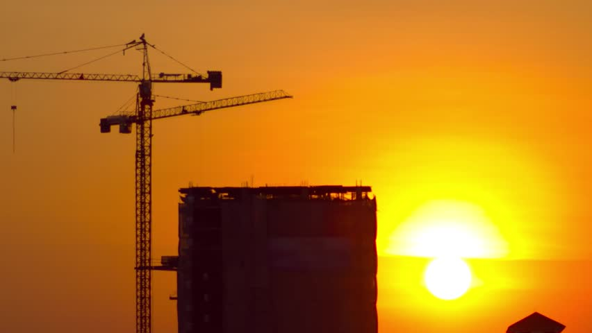 sun rising at construction site time lapse hd video
