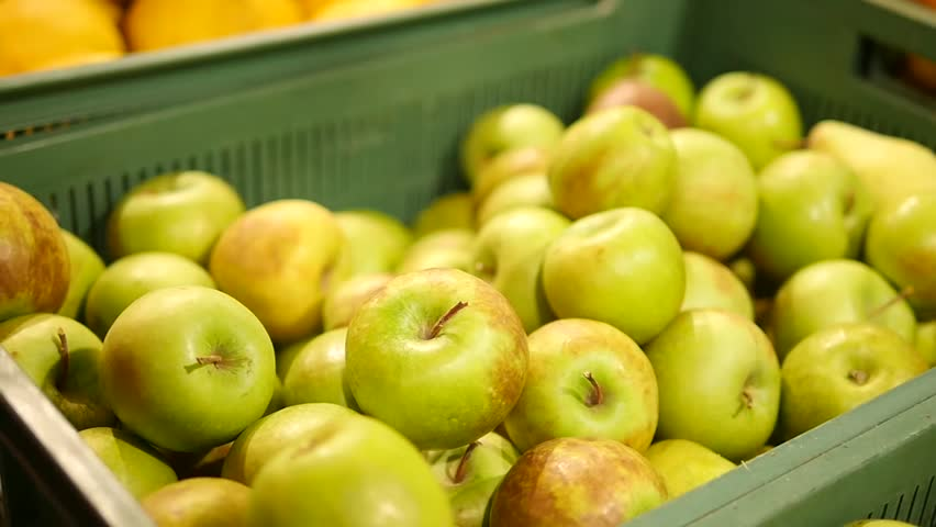Girl in supermarket selects green apples.  | Shutterstock HD Video #34849981