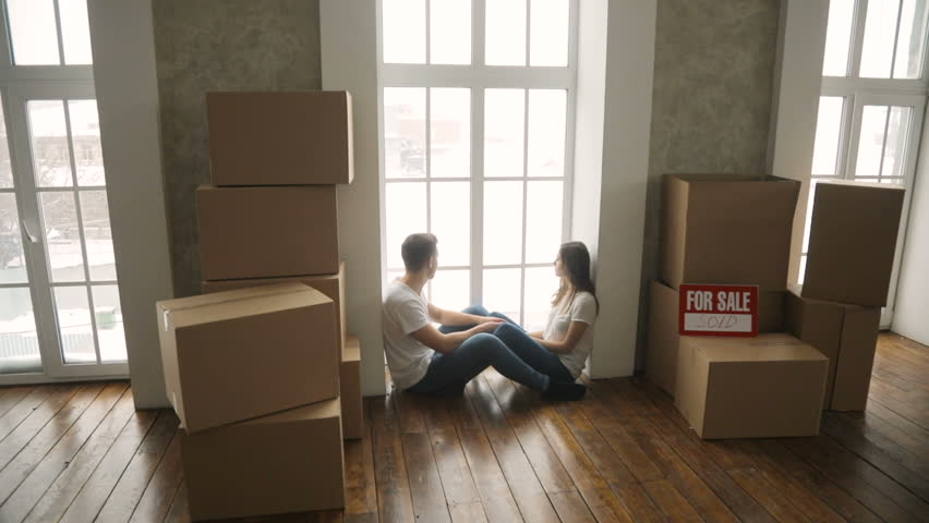 Young couple very happy and excited about moving into new apartment | Shutterstock HD Video #34858510