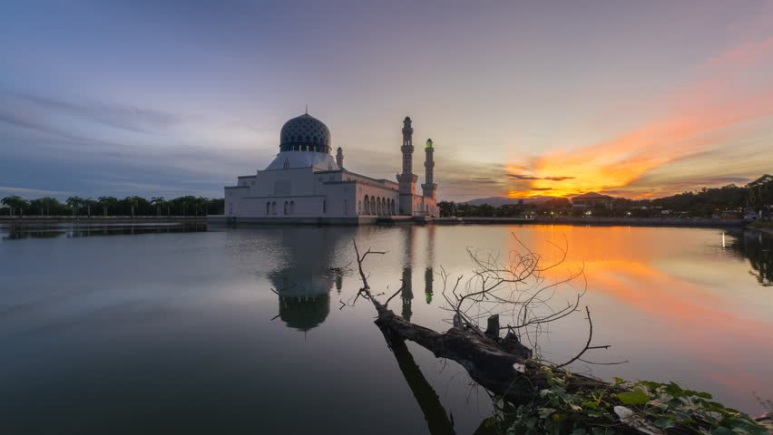 Time lapse of sunrise and scattered clouds at a mosque in Likas, Kota Kinabalu, Sabah, Malaysia. 4K resolution, 3840 x 2160.
