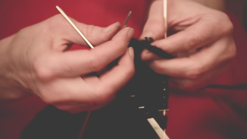 Close-up hands with knitting needles, beautiful woman knits. | Shutterstock HD Video #34872370