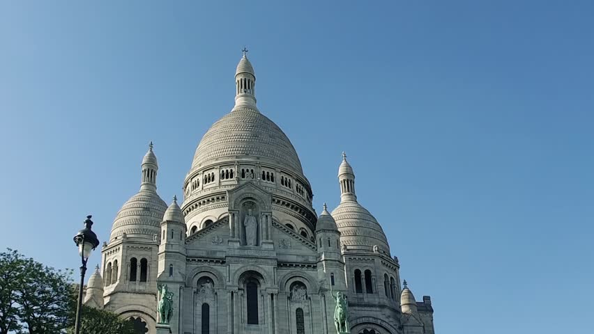 Cinematic view of exterior architecture of  Basilica Sacre Coeur in Montmartre in Paris, France | Shutterstock HD Video #34880506