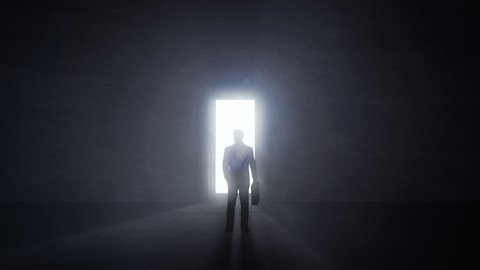 Man standing at at opening glowing door in darkness, light rays coming trough. Challenge concept.