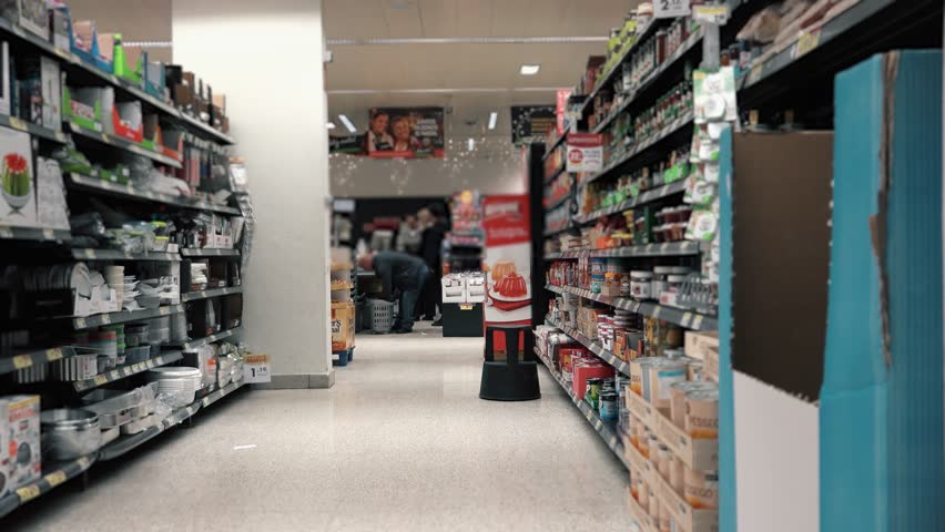 Supermarket Aisle With People In Cashier. Empty supermarket aisle with people paying the cashiers | Shutterstock HD Video #34886908