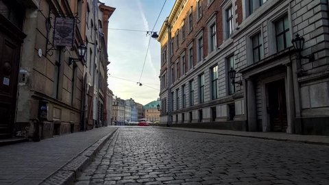Walking along the cobbled street of Old Riga at dawn, Latvia. Steadicam shot