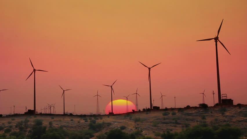 wind farm - turning windmills against timelapse sunrise