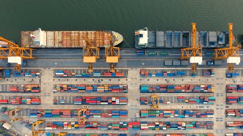 Container ships and lifting cranes in the Port in Bangkok Thailand. Aerial view by drone 4k camera.