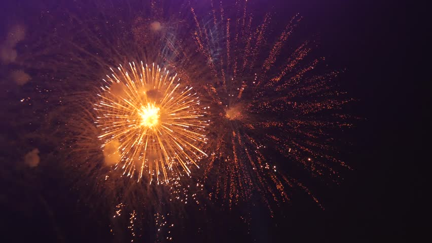 Cluster of colorful fireworks against dark sky   Shutterstock HD Video #34915030