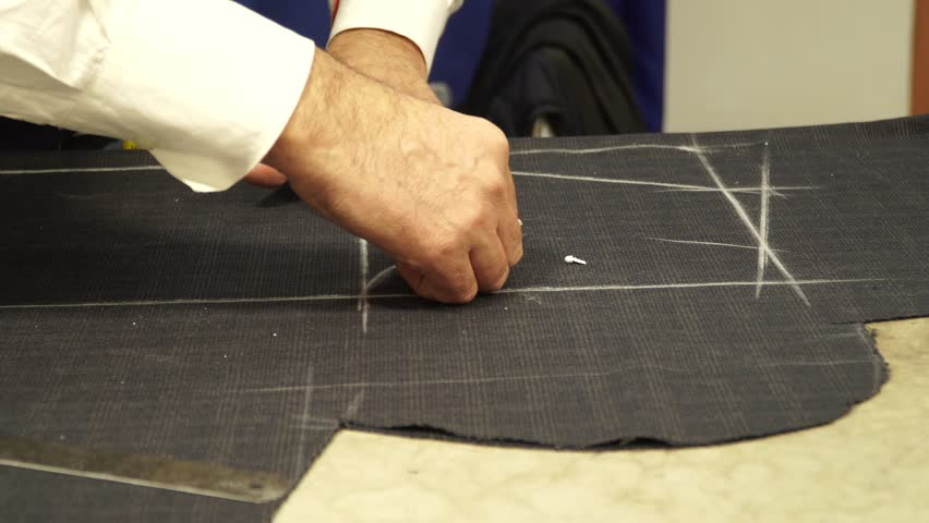 Tailor measures pieces of material   Shutterstock HD Video #34923760