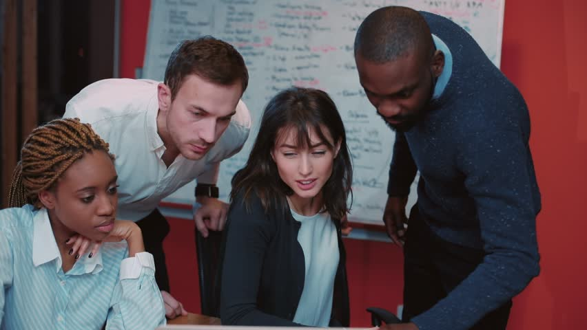 Group of colleagues leaning over laptop in modern beautiful office. Boss thanking employee for brilliantly prepared presentation, shaking hands. Smiling. | Shutterstock HD Video #34937629