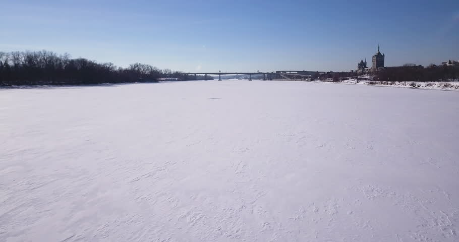 Drone aerial shot flying over a frozen lake towards a bridge during winter storm in Albany, Upstate, New York captured in 4k   Shutterstock HD Video #34943107