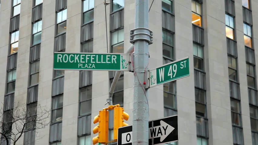 New York City shot of two street signs on the corner of Rockefeller Plaza and W 49 Th Street. A small bird lands on the sign before flying away, playing with another one. | Shutterstock HD Video #34946260