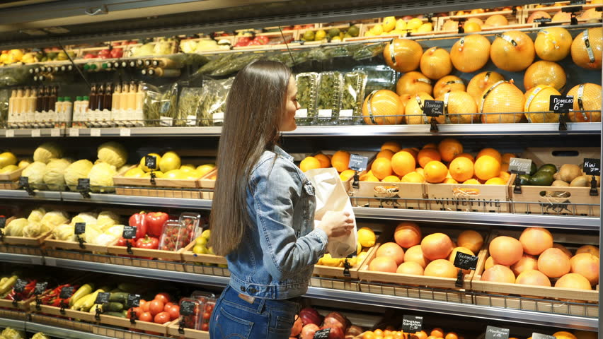Beautiful young woman shopping for fruits and vegetables in a production department. Grocery store. Supermarket. Healthy lifestyle. | Shutterstock HD Video #34968187