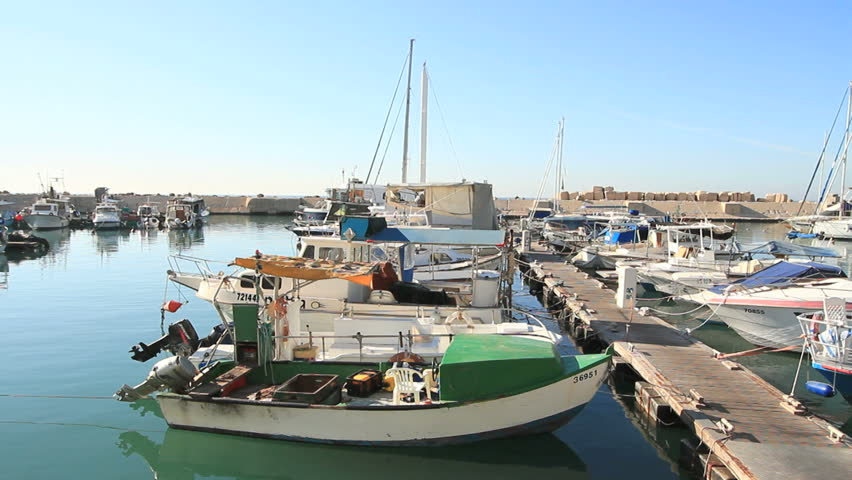 long shot of boats being anchored at Jaffa port