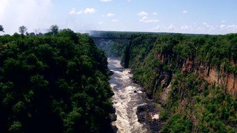 Breathtaking aerial view of the Victoria Falls Bridge crossing the Zambezi River