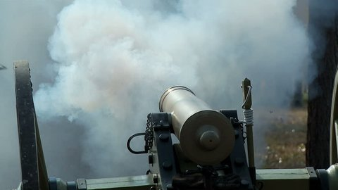 OLUSTEE, FL - FEB 2013 - Civil War Cannon (Union Army) Fires on the edge of a wood-line in the middle of battle.  High-speed recording from within the lines of battle.  Filmed on original battlefield.
