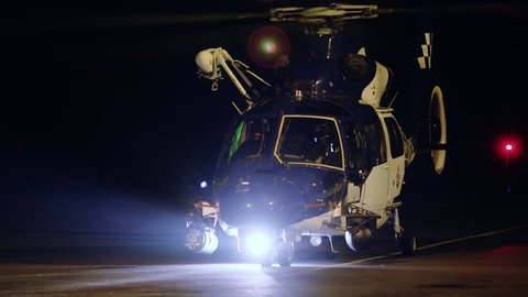 Police Helicopter landing at night at Portland Airport after rescue operation - May 30 2014.