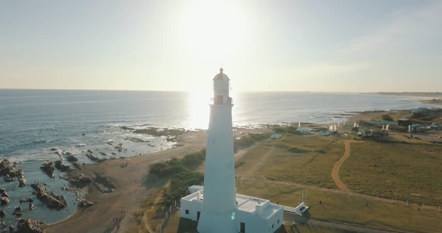 the beautiful lighthouse on the edge of the sea in aerial shot,  Uruguay, Rocha, la paloma,
