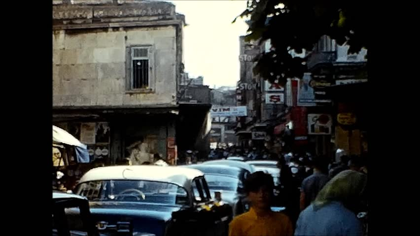 ISTANBUL, TURKEY - CIRCA 1969: Marketplace and traffic scenes nearby the harbor. Vintage 8mm film scan.