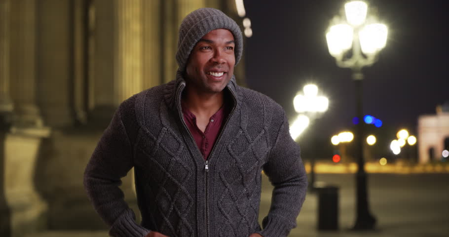 Young black man in Paris shivering outside on a cold night. African male traveling in Paris, France standing outside in winter clothes on a freezing night. 4k | Shutterstock HD Video #35018140