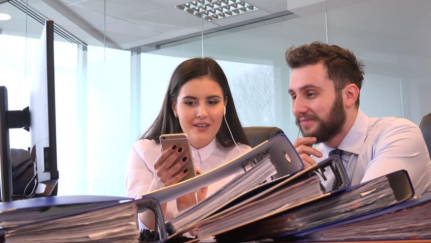 Cheerful carefree business team colleagues listen earphones music happy talking  | Shutterstock HD Video #35032480
