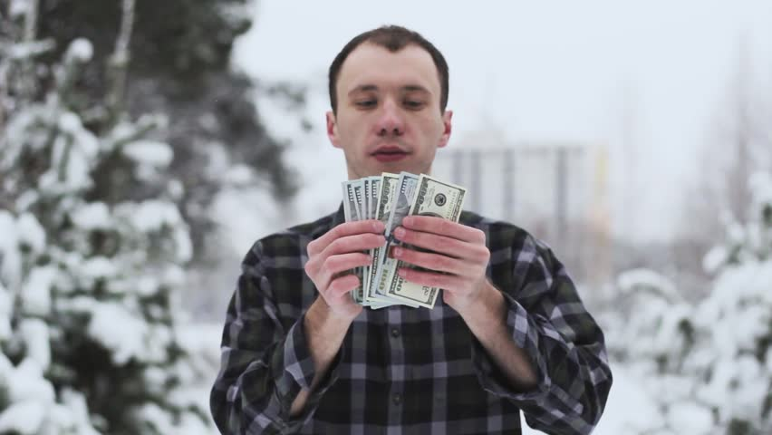 A wealthy guy counts money | Shutterstock HD Video #35038279