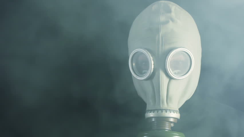 Black background. Thick smoke hides man in a gas mask. The smoke dissipated | Shutterstock HD Video #3505910