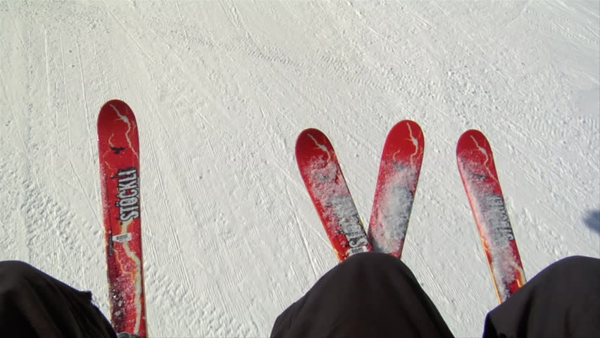 UTAH - CIRCA 2010: Shot of skis on chairlift, snowy hill below