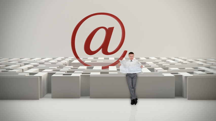 Businessman with Map trying to find his way in a Maze with Internet Mail Sign