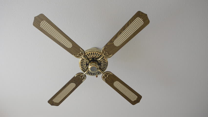 switching on an electric fan on the ceiling