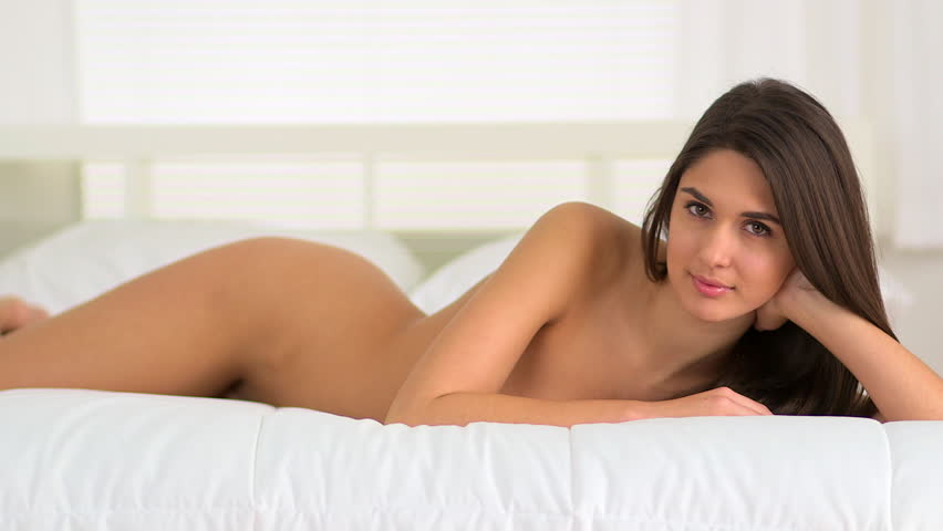 Nude gril on bed
