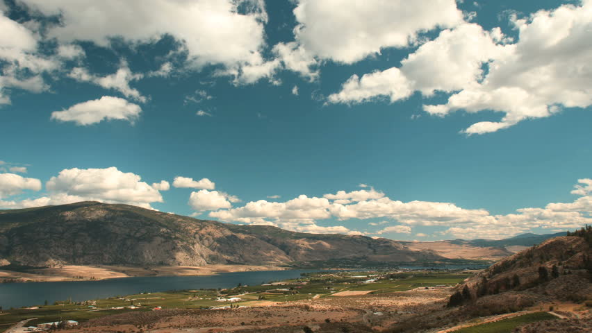 Osoyoos Valley and Lake Timelapse, British Columbia. Timelapse view of Osoyoos Lake and the Town of Osoyoos in the Southern Okanagan Valley. British Columbia, Canada.