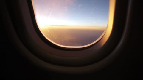 airplane window view at sunset sunrise 1080 HD passenger aircraft aviation airline flying traveling busyness