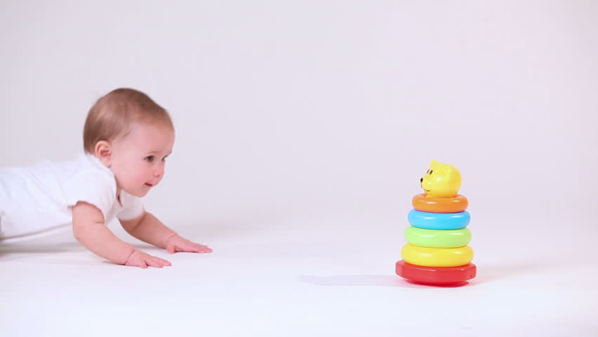 Baby play with pyramid