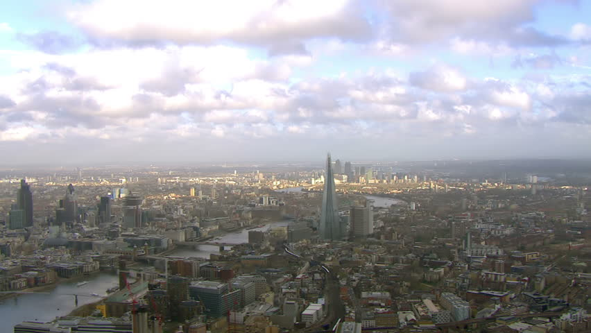 Stunning panoramic aerial view and cloudscape, flying over the city of London and the River Thames on a bright day #3578576