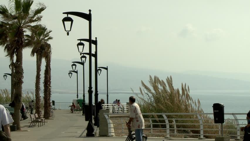 AL RAOUCHE, BEIRUT - CIRCA 2012: Medium shot of man sitting on bench and