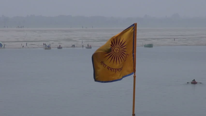 hinduism ceremony flag on Ganges river coast in Varanasi,India