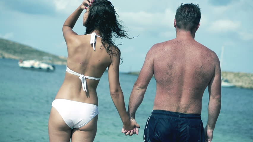 Couple in love standing on the beach, slow motion shot at 120fps  | Shutterstock HD Video #3646610