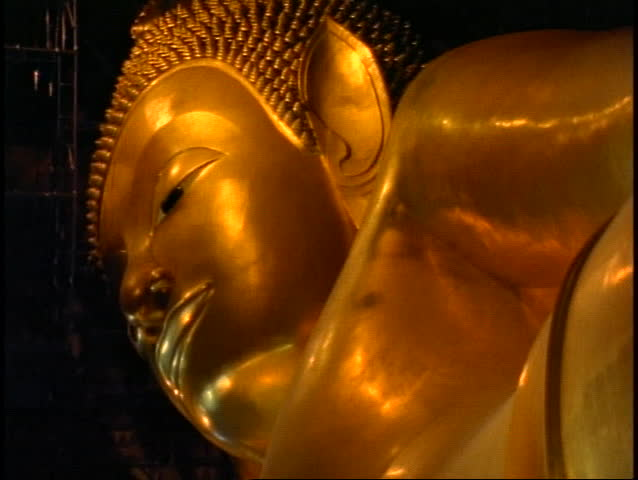 Temple of the Reclining Buddha, The Golden Buddha, close up face of gold