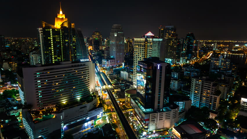 BANGKOK - 30 MARCH: Time lapse view of Bangkok skyline at night. Top view of