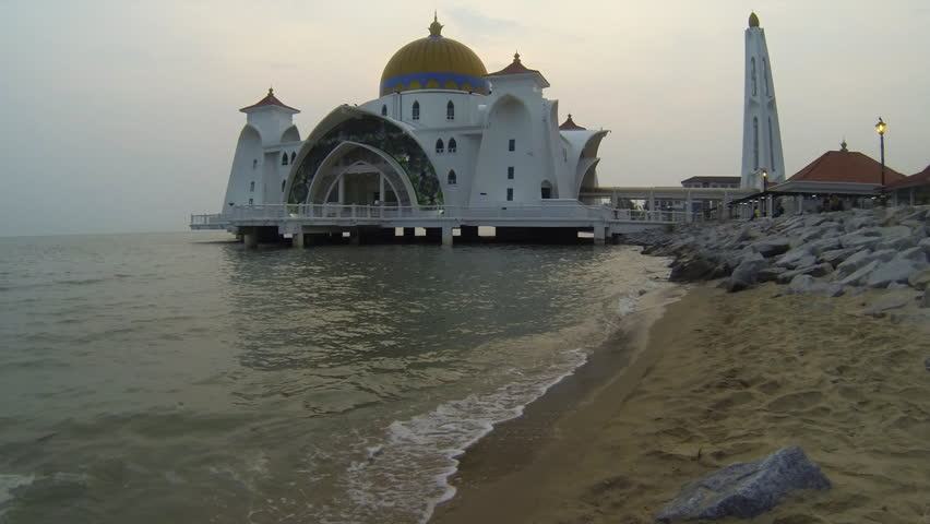 Time lapse with zoom  at sunset of Selat Mosque in Malacca island Malaysia also known as Malacca Straits mosque