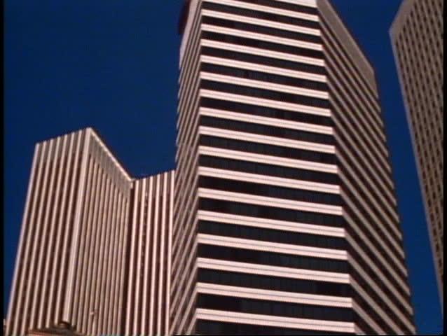 San Francisco, 1970's, modern skyscraper, no people, tilt up, medium shot