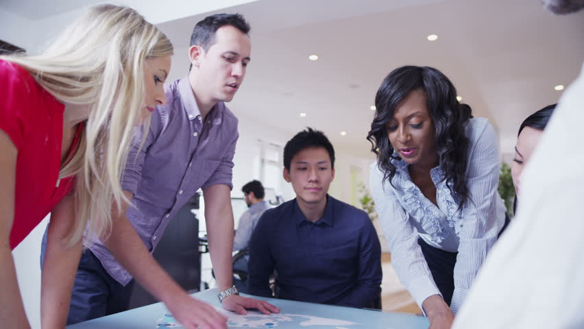 A multi-ethnic business team are working in a...