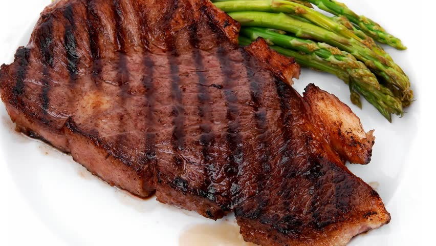 Meat Table Grilled Beef Fillet With Asparagus Served On White Plate Isolated Over White