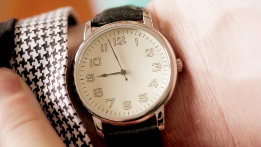 Businessman checking wrist watch | Shutterstock HD Video #3735821