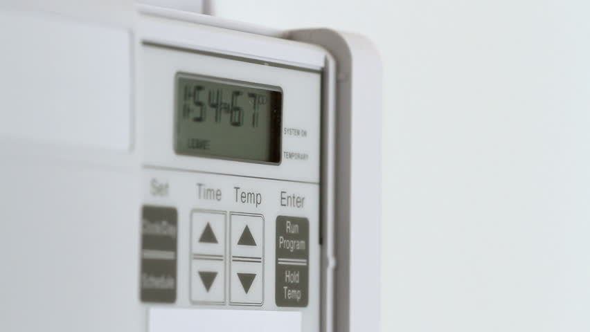 Setting the temperature to 72 degrees and then to 62 degrees on a thermostat. Big close up recorded with a macro lens. | Shutterstock HD Video #3737000