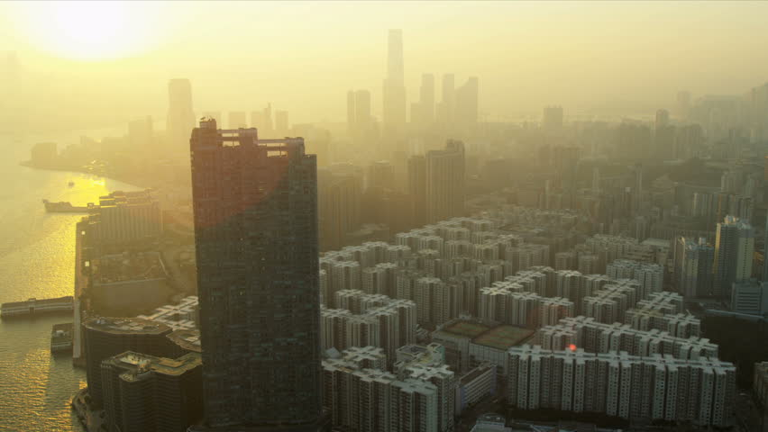 Aerial sunset view of Condominiums Kowloon Victoria Harbour, China, RED EPIC | Shutterstock HD Video #3740600