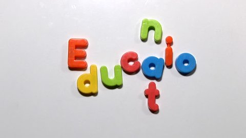 Stop motion animation of fridge magnets moving to spell the word education